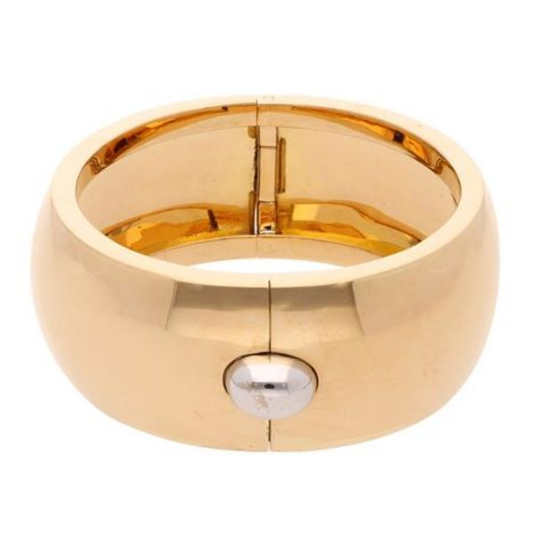 Oferta de Brazalete articulado liso firma Tane en oro dos tonos 18 kilates. por $172630