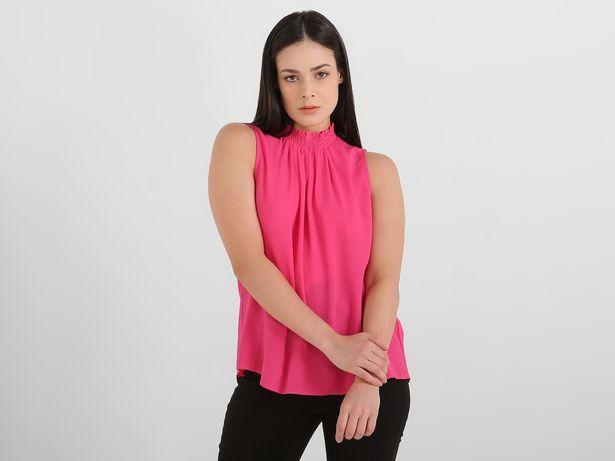 Oferta de Blusa Contempo cuello alto sin manga por $238