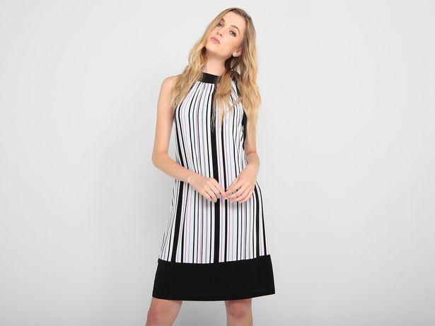 Oferta de Vestido Contempo a rayas sin manga por $199