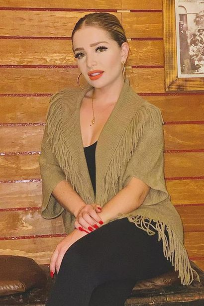Oferta de Suéter liso con flecos por $181